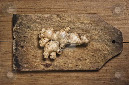Ginger  stock photo, Ginger rhizome on a wooden cutting table. by Pablo Caridad