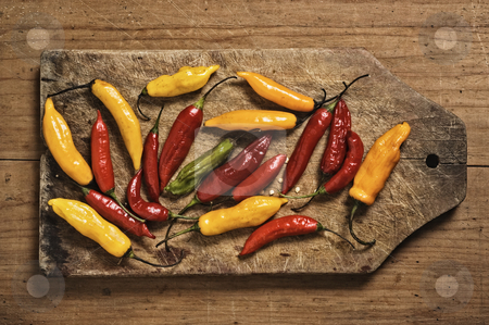 Assorted bolivian chili peppers stock photo, Assorted bolivian chili peppers on cutting table. by Pablo Caridad