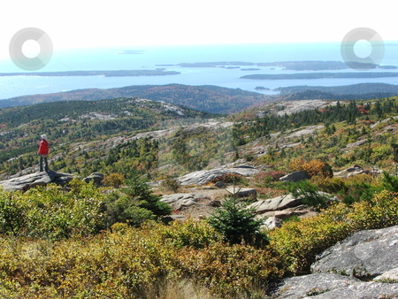 Maine's Cadillac Mountain stock photo, Cadillac Mountain on Mount Desert Isle in Acadia National Park near Bar Harbor, Maine is the tallest mountain (1,528) bordering the eastern seaboard and easily accessible  by car for tourists. This vantage point is from the summit looking southwest toward neighboring islands and the Atlantic. by Dennis Thomsen