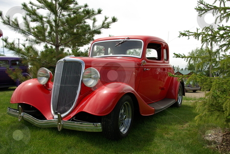 Bright Red 1934 Ford Coupe stock photo, Images of this 1934 Ford coupe show how a vintage car can be restored and brought back to life with skill, hard work,  and money.  The antique auto was displayed at the Pequot Lakes, Minnesota Car Show on June 7, 2008. by Dennis Thomsen