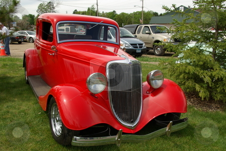 Red 1934 Ford Coupe stock photo, Images of this 1934 Ford coupe show how a vintage car can be restored and brought back to life with skill, hard work,  and money.  The antique auto was displayed at the Pequot Lakes, Minnesota Car Show on June 7, 2008. by Dennis Thomsen