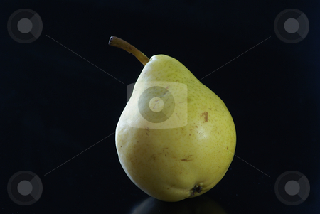 Pear stock photo, Close up of green pear on a black background by Serge VILLA
