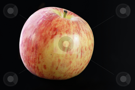 Apple stock photo, Close up of a red and yellow apple on a black background by Serge VILLA