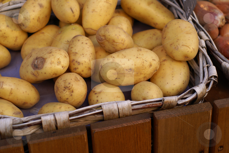Potatoes stock photo, Basket of Potatoes in a french Market by Serge VILLA