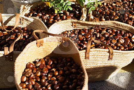 Chesnuts in Market stock photo, Baskets of chesnuts in a Provencal market by Serge VILLA