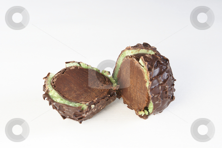 Chocolate sweet stock photo, Chocolate sweet chestnut with cut heart in praline-flavoured chocolate. by Serge VILLA