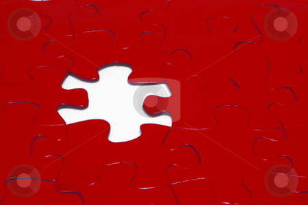 Jigsaw Puzzle stock photo, A close-up of a jigsaw puzzle with a missing puzzle piece. by Robert Byron