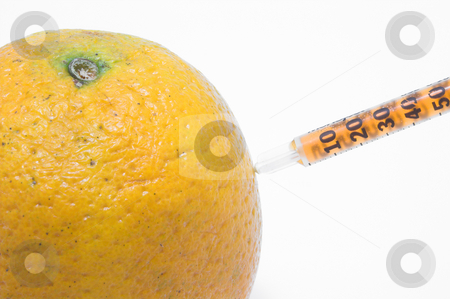 Orange and Syringe stock photo, An orange being injected with juice from a syringe. by Robert Byron
