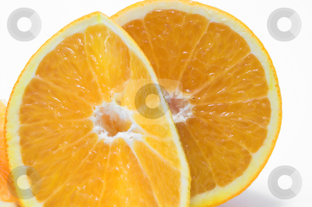 Sliced Orange stock photo, Cross sections of fresh and juicy oranges. by Robert Byron