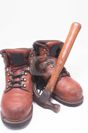 Work Boots and Hammer stock photo, A pair of steel toed work boots and a claw hammer. by Robert Byron