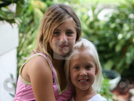 Young girls posing stock photo, Two blonde haired young girls holding one another by Lori Kirk