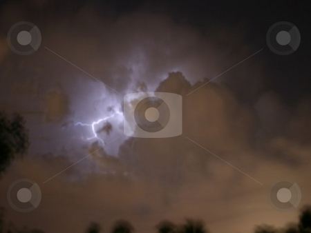 Nightstorm stock photo, Lightning sparking through the clouds during a storm by Lori Kirk