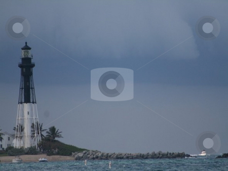 Lighthouse storm stock photo, Lighthouse in the distance as a storm rolls in by Lori Kirk