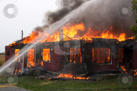 Abandoned House in flame stock photo, Abandoned house in flame with firefighters in action by Claude Beaubien