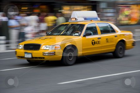 Yellow Taxi cab in motion stock photo, New York City yellow taxi cab in motion on a colorfull street by Claude Beaubien