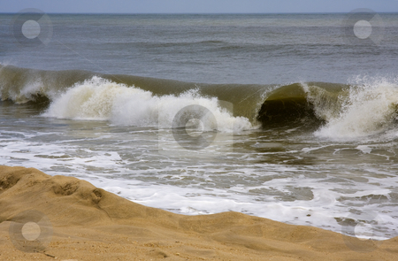 Rolling Waves on the Beach stock photo, Photo of a rolling wave going to the beach by Claude Beaubien