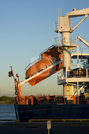 Lifeboat ready to go stock photo, Lifeboat on a freight cargo ready to go by Claude Beaubien