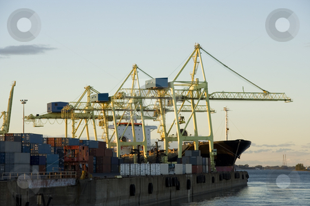 Container Cranes at Work stock photo, Container cranes loading a ship in a major port by Claude Beaubien