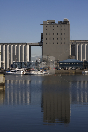 Grain Elevator and its Reflection stock photo, View of a grain elevator and its reflection on water by Claude Beaubien