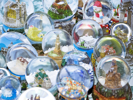 Snow globe stock photo, Lots of snow globes on table by Sinisa Botas