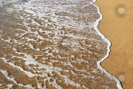 Wet sand stock photo, A sea wave on a wet sand by Ivan Paunovic