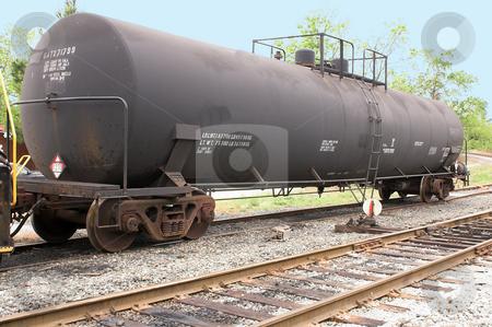 Train Tanker Car stock photo, A train tanker car on railroad tracks. by Robert Byron