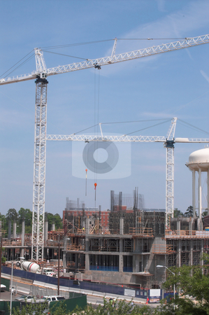 Construction Site stock photo, A construction site with large industrial cranes. by Robert Byron