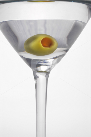 Martini stock photo, An olive in a very dry martini. by Robert Byron