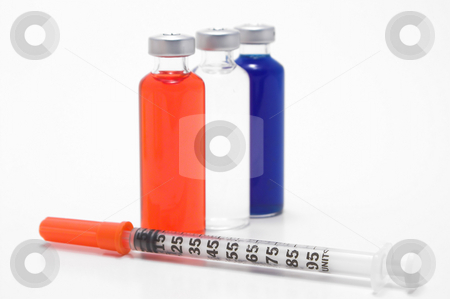 Medicine Vial and Syringe stock photo, Prescription medicine vials and a medical syringe. by Robert Byron
