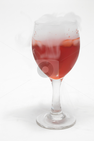 Smoking Wine stock photo, Smoke coming from a glass full of wine. by Robert Byron
