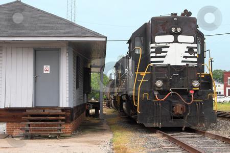 Diesel Train Engine stock photo, A Diesel Train Engine on railroad train tracks. by Robert Byron