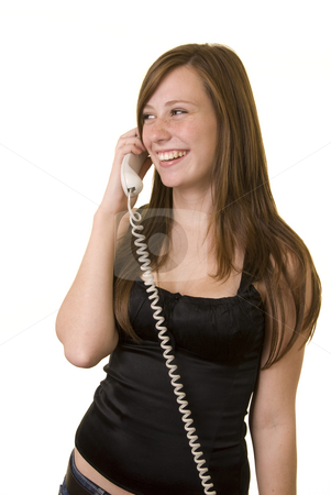 Nicci on the phone1 stock photo, Pretty young lady with a black top, isolated on a white background, talking on the phone, laughing. by Nicolaas Traut