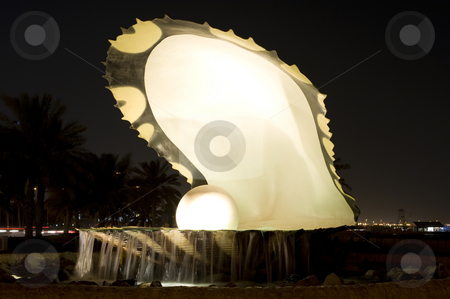 Pearl landmark Doha stock photo, The prominent Pearl inside a clamshell - well known landmark on the corniche in Doha, Qatar.  Picture taken at night. by Nicolaas Traut