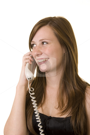 Young lady on phone stock photo, Pretty young girl with cute freckles wearing a black top, talking on the phone and smiling. by Nicolaas Traut