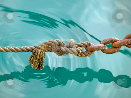 Rope  stock photo, Old rope with older chain above the water surface, somewhere in Adriatic Sea. by Sinisa Botas