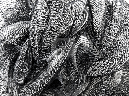 Curly nets stock photo, Black and white curving nets close up by Sinisa Botas