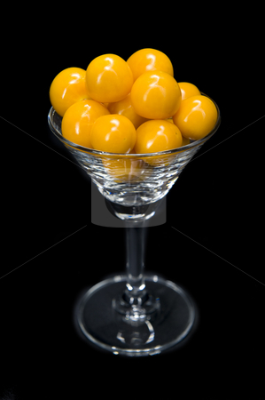 Gooseberry cocktail stock photo, Freshly opened gooseberries presented in a cocktail glass looking delicious. The presentation is isolated on black. by Nicolaas Traut
