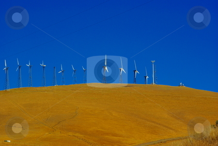 Wind Powered Electrical Generators stock photo, Wind powered  electric generating stations sit on top of  dry grass covered hill in Livermore California. by Lynn Bendickson