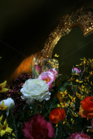Plastic flowers resting on Gold Mirror stock photo, Plastic flowers with Gold Mirror by Daniel Martin
