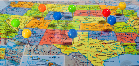 Map of USA stock photo, Map of the USA with colorful pins at various locations by Robert Cabrera