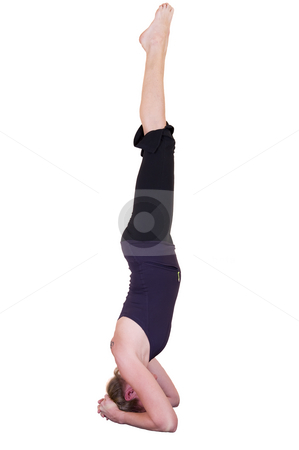 Yoga headstand stock photo, Attractive mature lady doing yoga 'Headstand - Salamba Sirsasana' isolated on white. by Nicolaas Traut