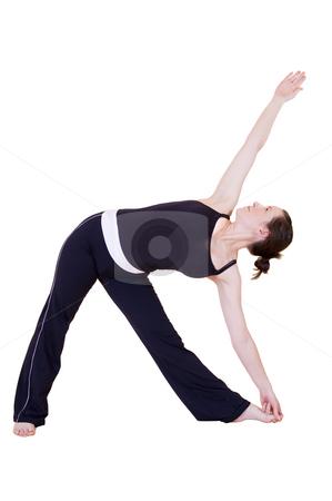 Yoga triangle pose stock photo,  by Nicolaas Traut
