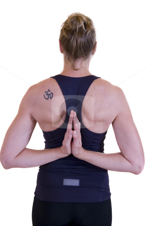 Yoga woman stock photo, Beautiful mature lady doing yoga, hand together behind her back and showing a tattoo on the left shoulder. by Nicolaas Traut