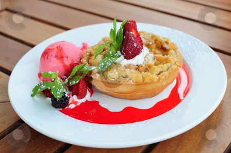 Freshly baked apple pie stock photo, Delicious looking freshly baked apple pie at an outside restaurant, on a wooden table. by Nicolaas Traut