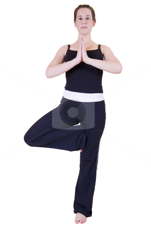 Yoga tree pose stock photo, Beautiful young lady in the yoga 'Tree pose - Vriksasana', dressed in black and isolated on white. by Nicolaas Traut