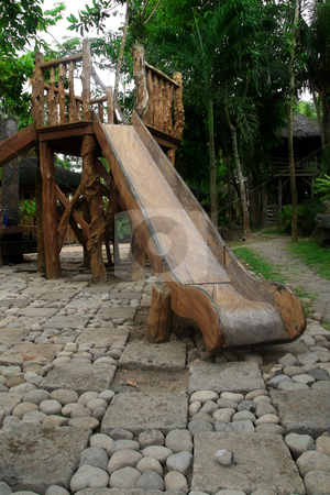 Wooden slide stock photo, Wooden playground slide on a tropical resort by Jonas Marcos San Luis