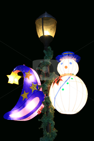 Hat and snowman lanterns stock photo, Wizard hat and snowman lanterns hanging at a lamp post by Jonas Marcos San Luis