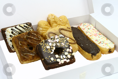 Fancy donuts stock photo, Boxed donuts in fancy shapes and flavors by Jonas Marcos San Luis