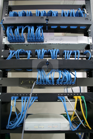 Cabling rack stock photo, Cabling rack with patch panels hubs and switches by Jonas Marcos San Luis