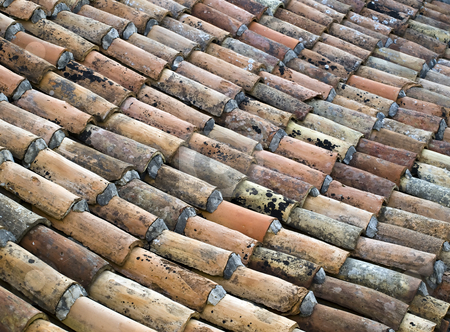 Roof tiles stock photo, Old roof in many colors. by Sinisa Botas